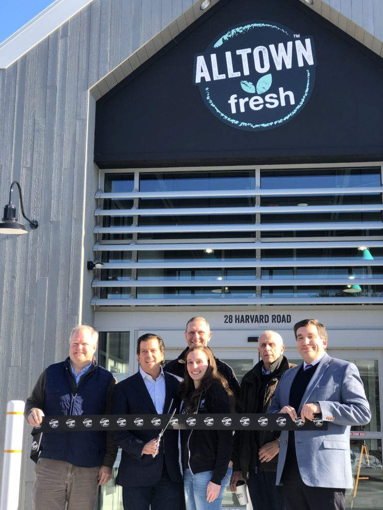Ribbon cutting in front of the new Alltown fresh in Ayer, Massachusetts
